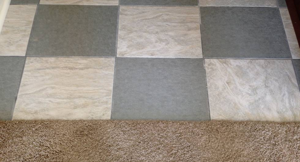 Checker board ceramic tile and good quality carpet.